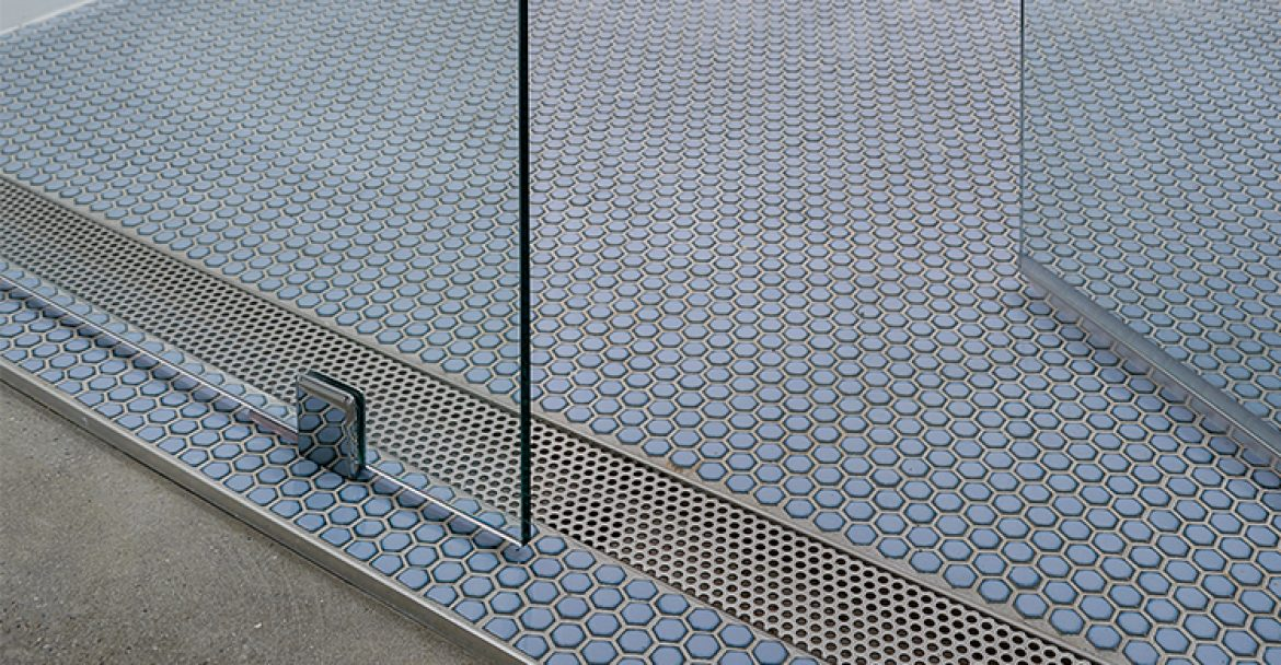 The difference between a standard or fixed length linear drain and an adjustable linear drain
